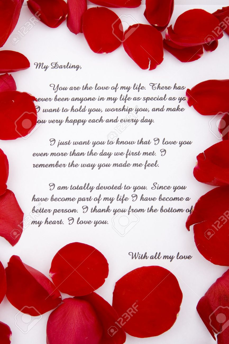 A Romantic Love Letter With Rose Petals. Stock Photo, Picture And